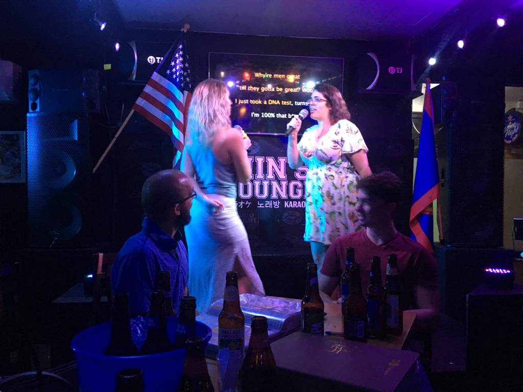 Enjoy karaoke with friends during a night out in Guam