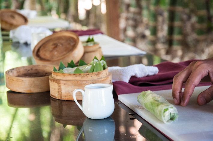 Students make traditional Cambodian spring rolls at cooking class in Siem Reap.