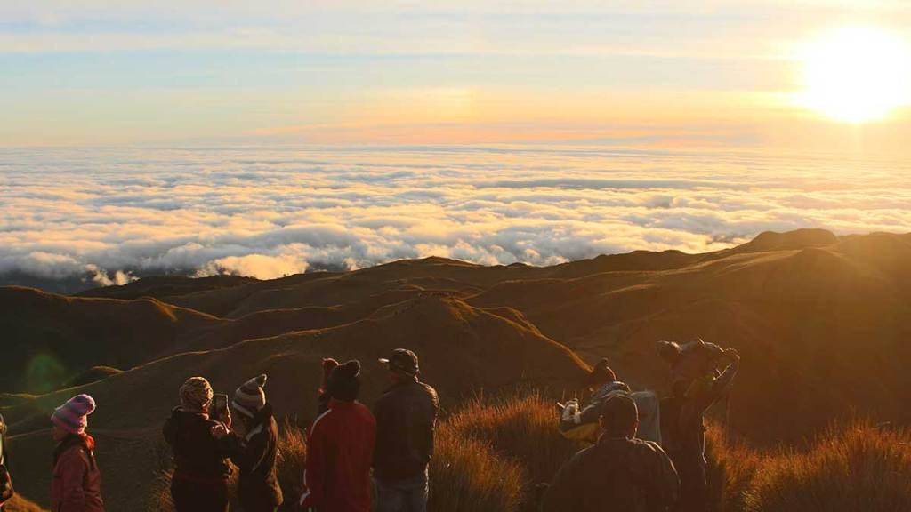 Standing at the top of Mount Pulag in the Philippines