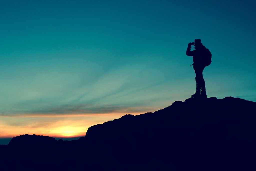 Traveler standing on top of a mountain