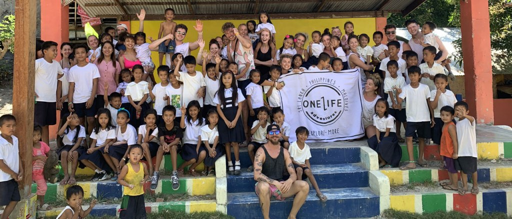 The One Life Adventures team volunteering at a local school